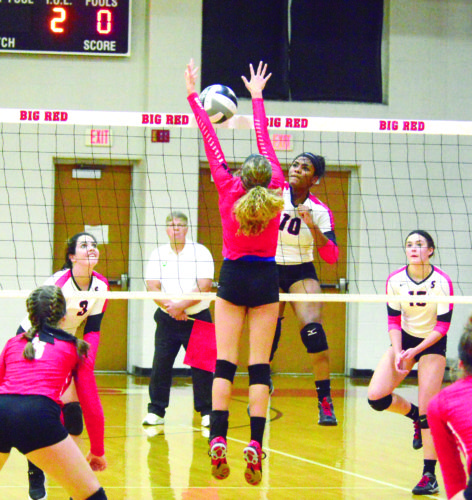 FIRST TEAM HONORS — Steubenville's Jaliyah Hubbard attempts a kill against Minerva in a sectional contest on Oct. 16. Howard was named a first-team Division II volleyball player by the Ohio District 5 Volleyball Coaches Association. (Photo by Michael D. McElwain)