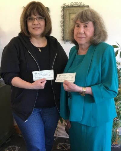 DONATIONMADE — Carol Sheerbaum, left, from the Hancock County 4-H Conservation Camp, was presented a donation from Carol Village, chairman of the Garden Department, a part of the Weirton Woman's Club. -- Contributed