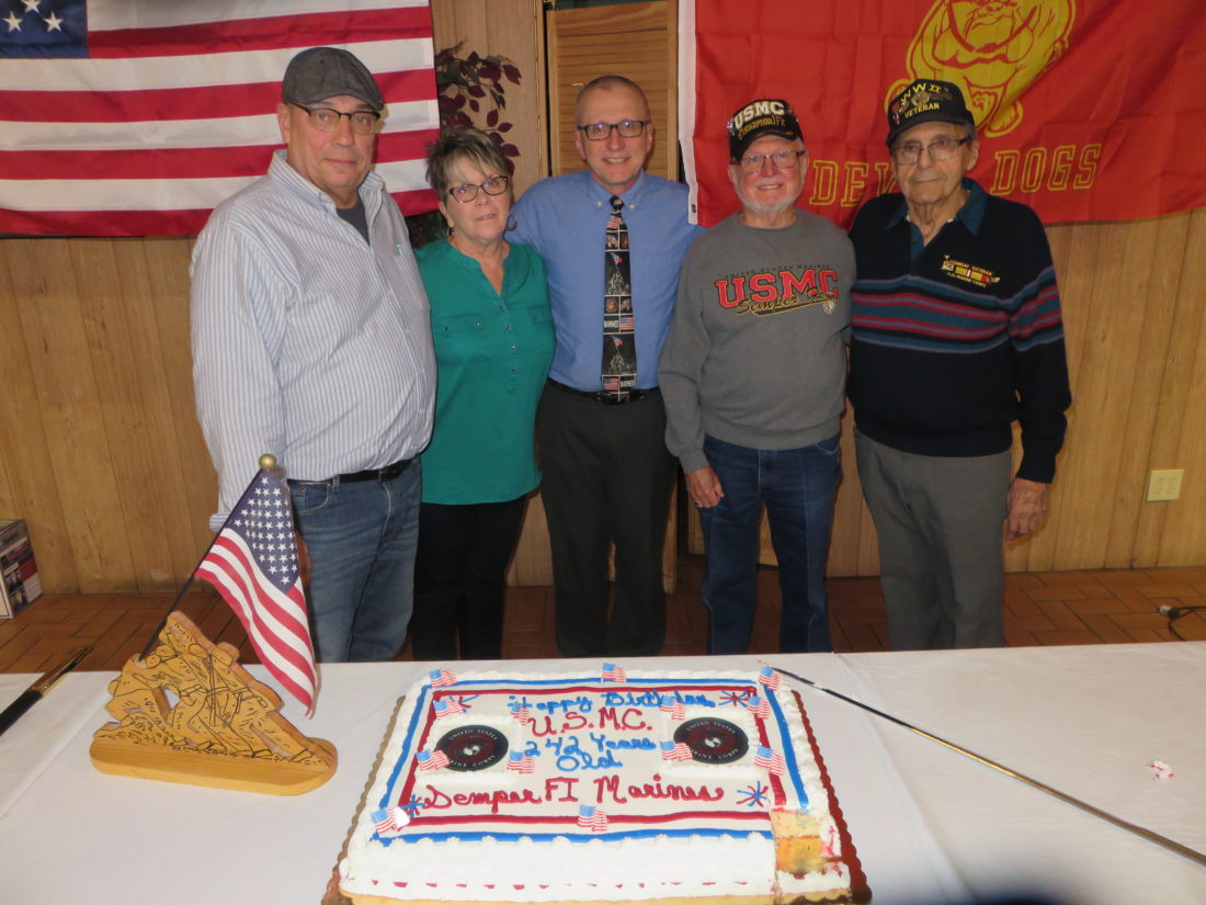 BIRTHDAY NO. 242 — The 242nd birthday of the Marine Corps was marked Friday by members of the Band of Brothers during their annual observance at Zalenski's in Wintersville. On hand for the occasion were, from left, special guests Gold Star parents Tim and Adriana Rock of Toronto, whose son, Marine Sgt. Nathaniel S. Rock, died 12 years ago while serving during Operation Iraqi Freedom; Rick Oddi of Burgettstown, youngest Marine in attendance; Marine veteran Bill Shipe, master of ceremonies; and Len Masci of Wintersville, oldest Marine in attendance. -- Janice Kiaski
