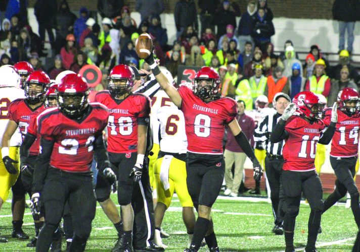 RECOVERING — Steubenville's Johnny Agresta (8) celebrates after recovering his second fumble against Cardinal Mooney in a Division IV, Region 13 semifinal on Friday in Salem. Also shown are Big Red's Jonathon Blackmon (48) and Randy Mitchell (14). (Photo by Joe Catullo)