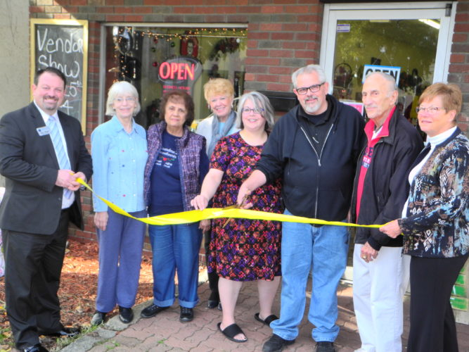 "UNIQUE CRAFTS OFFERED — Recently opened at 1031 Main St., Follansbee, Moe's on Main offers a variety of unique handmade crafts. The new shop is owned by Elmer ""Moe"" Myers and his wife, Monica Rotellini-Myers. On hand for a ribbon cutting to celebrate the shop's opening were, from left, chamber member Eric Fithyan; Monica's mother, Carol Boyce; chamber members Carmel Esposito and Pat Accetollo; the Myers; Chamber President Tony Paesano; and chamber member Charlotte Kolenc. - Warren Scott"