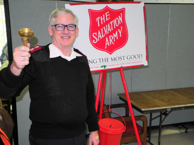BELLS WILL BE RINGING — Maj. Mike Morton of the Brooke and Weirton Salvation Army is seen with one of the many kettles used to collect donations to help local residents in need. Salvation Army bell ringers can be found at many Brooke and Hancock county locations this weekend as the nonprofit organization begins its regular Christmas campaign, which allows it to help people throughout the year. -- Warren Scott