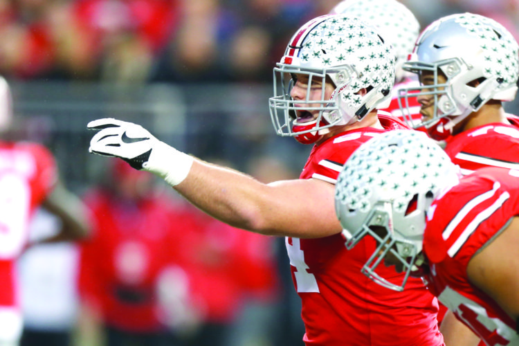 SETTING UP THE OFFENSE — Ohio State offensive lineman Billy Price plays against Illinois Saturday in Columbus. (AP Photo)