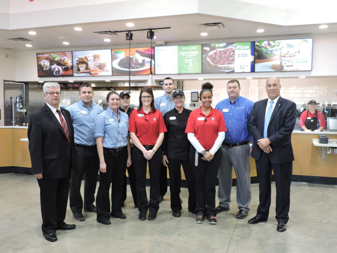 OPEN FOR BUSINESS — Pilot Flying J opened for business on state Route 7 in Steubenville Monday and almost immediately was  filled with customers. Taking time to gather for a photo in front of the Pilot Flying J deli were, from left, Mayor Domenick Mucci, General Manager Brandon Ohler, Kiera Eicher, Teri Bado, Brianna Schramm, Concept Food Manager Blake Davis, Linda Perdew, Nikki Hython, Regional District Manager Wade Arthur and City Manager Jim Mavromatis. -- Dave Gossett