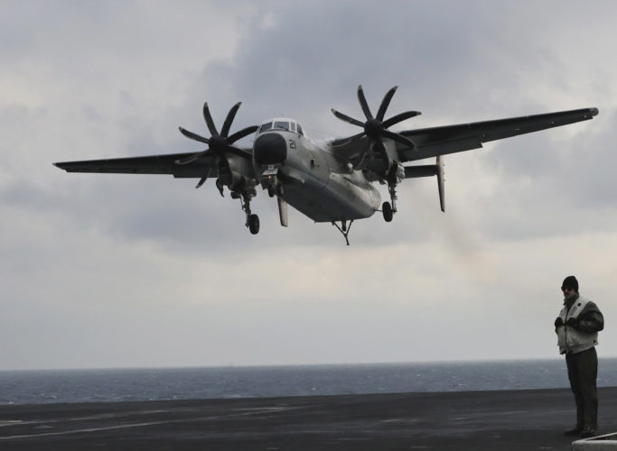 ON APPROACH — A Navy C-2 Greyhound approaches the aircraft carrier USS Carl Vinson in March. A Greyhound crashed into the Pacific Ocean Wednesday with 11 aboard while flying to the USS Ronald Reagan. Eight have been rescued and a search continues for the other three who were aboard the plane. -- Associated Press