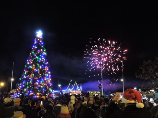 """LIGHTING UP THE NIGHT — A 10-minute fireworks show lit up the skies over Steubenville Tuesday night within seconds of the official Christmas tree lighting ceremony in the Historic Fort Steuben Park. City Manager Jim Mavromatis and nine """"elves"""" financed the fireworks display. -- Dave Gossett"""