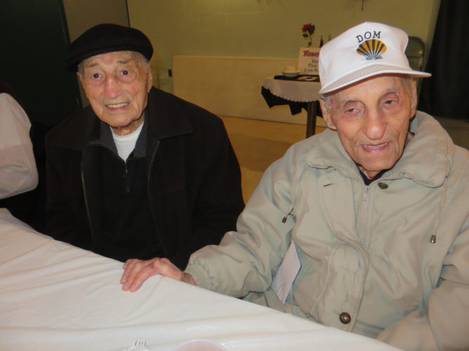 Friends since their Weir High School days are Army veterans Guy Ceraolo, 98, left, and Dominic Schell, 96, who attended the Christmas party. -- Janice Kiaski