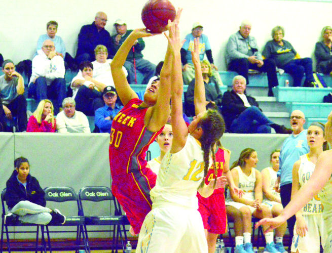 MAKING AN IMPACT — Indian Creek's Taylor Jones attempts a tough putback past Oak Glen's Alexa Andrews on Thursday. (Photo by Joe Catullo)