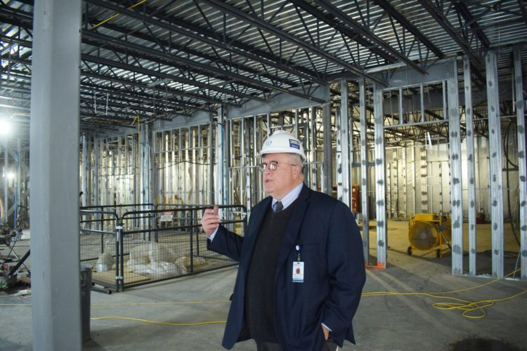 Wheeling Hospital Vice President John Pastorius explains features of the hospital's new Continuous Care Center as he stands in the main lobby area that is under construction. --  Scott McCloskey
