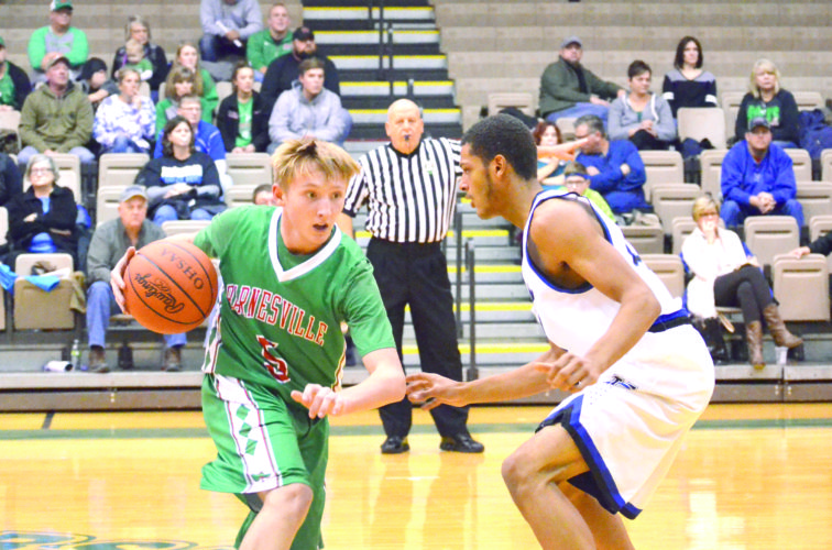 DEFENDING — Barnesville's Kyle Keiser (5) dribbles against Harrison Central's Tyler West (21) during Saturday's third game of the Buckeye 8 Challenge at Ohio University Eastern. (Photo by Rick Thorp)