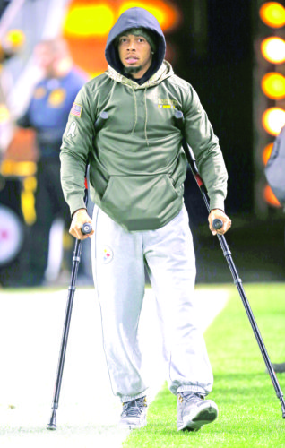 WALKING TALL — Pittsburgh Steelers cornerback Joe Haden walks with crutches before a game against the Tennessee Titans on Nov. 16 in Pittsburgh. (AP Photo)
