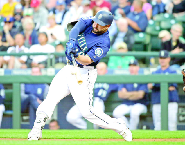 DOUBLING UP — Seattle Mariners' Yonder Alonso doubles against the Baltimore Orioles in the first inning on Aug. 14 in Seattle. A person familiar with the negotiations says free-agent first baseman Yonder Alonso and the Cleveland Indians have agreed to contract terms. (AP Photo)