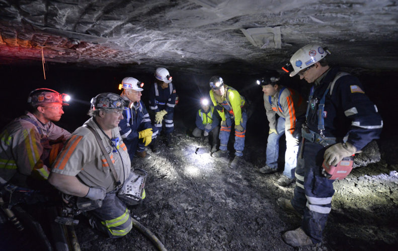 SAFETY IN THE MINES — Federal officials meet with miners in the Gibson North Mine in Princeton,Ind., in 2015. Coal mining deaths surged in 2017, according to federal statistics, a year after they had hit a record low. West Virginia led the grim statistics with eight miners losing their lives during 2017. Kentucky was next with two deaths. All told, 17 miners died on the job in 2017. -- Associated Press