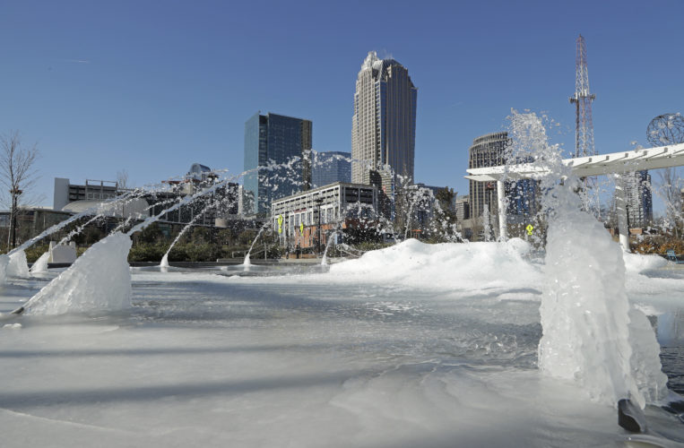 CHARLOTTE? YES, CHARLOTTE — Water squirts from a frozen fountain near downtown in Charlotte, N.C., Tuesday. Temperatures plummeted early Tuesday to 2 degrees in the north Georgia mountains, 14 in Atlanta and 26 as far south as New Orleans as the Gulf Coast felt more like Green Bay. -- Associated Press