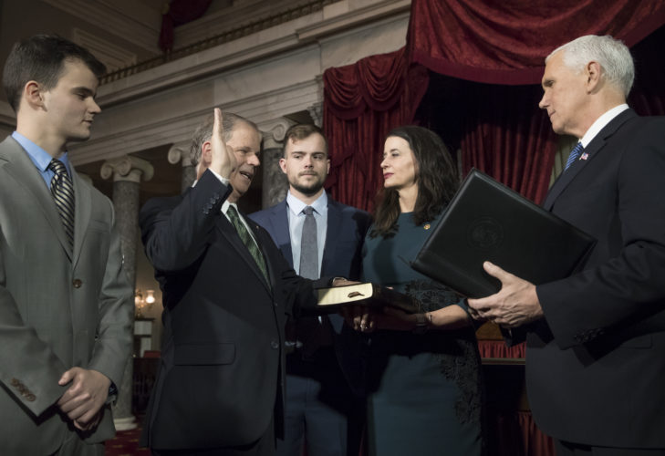 ADMINISTERSOATH — Vice President Mike Pence, right, administers the Senate oath of office during a mock swearing in ceremony in the Old Senate Chamber to Sen. Doug Jones, D-Ala., second from left, with his wife Louise Jones, second from right, Wednesday, on Capitol Hill in Washington. They are joined at far left by their son Christopher Jones, and son Carson Jones, center. Jones defeated Republican Roy Moore in a special election to take the seat once held by Attorney General Jeff Sessions. -- Associated Press