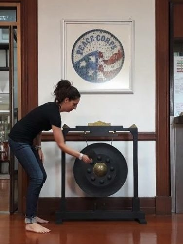 """IT'SOFFICIAL — Former area resident Amber Pestian participated in the Peace Corps """"Striking the Gong"""" ceremony during 2017 after having served 27 months in Thailand. After three strikes of the gong, a Peace Corps Volunteer is officially an RPCV, an acronym for Returned Peace Corps Volunteer. -- Contributed"""