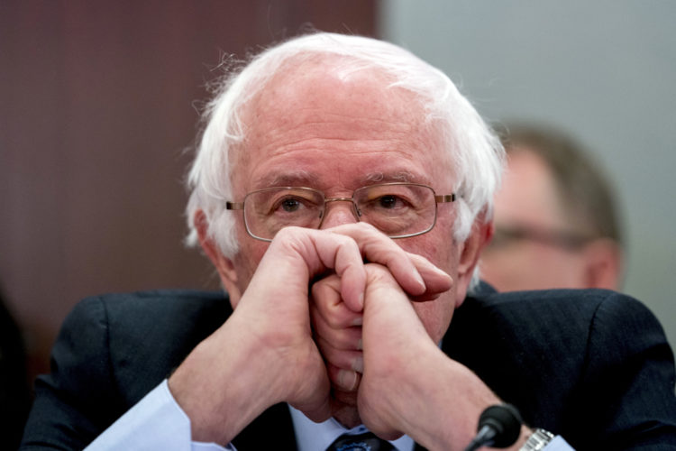 OFFENSIVE FOR HEALTH CARE — Sen. Bernie Sanders, I-Vt., attends a House and Senate conference on Capitol Hill in Washington Dec. 13. Democrats say they're shifting to offense on health care, emboldened by successes in defending the Affordable Care Act. They say their ultimate goal is a government guarantee of affordable coverage for all. -- Associated Press