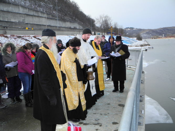 BLESSING ON THE RIVER — Clergy from several area Orthodox churches delivered a blessing for the Ohio River Sunday at the Steubenville Marina. Among those participating were, from left: the Rev. Michael Ziebarth of Orthodox Christian Church of the Life-giving Fountain; the Rev. Nicholas Halkias of Holy Trinity Greek Orthodox Church of Steubenville, the Rev. Andrew Nelko of St. Nicholas Orthodox Church of Weirton, the Rev. John Kopcha of St. Andrew's Orthodox Church of Mingo Junction and the Rev. Frank Milanese of All Saints Greek Orthodox Church of Weirton. During the service three ice crosses comprised of frozen holy water were tossed into the river. -- Warren Scott