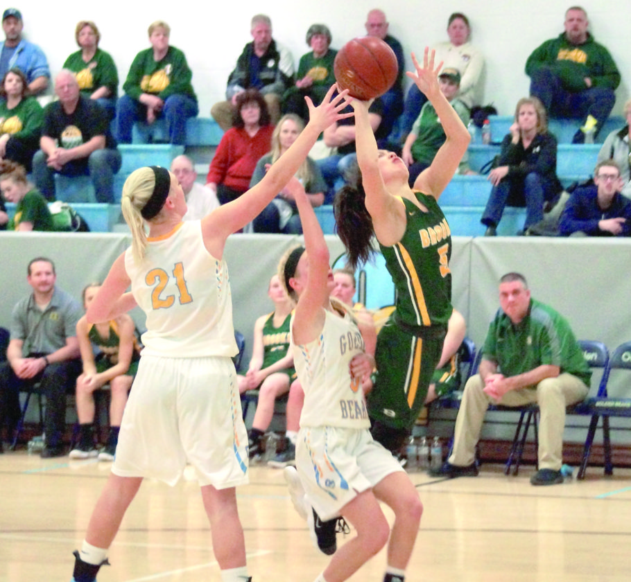 TOUGH SHOOTING — Brooke's Ashley Arca drives to the hoop past Oak Glen's Maggie Kovalcik and Emmy Severs (21) on Thursday. (Photo by Andrew Grimm)