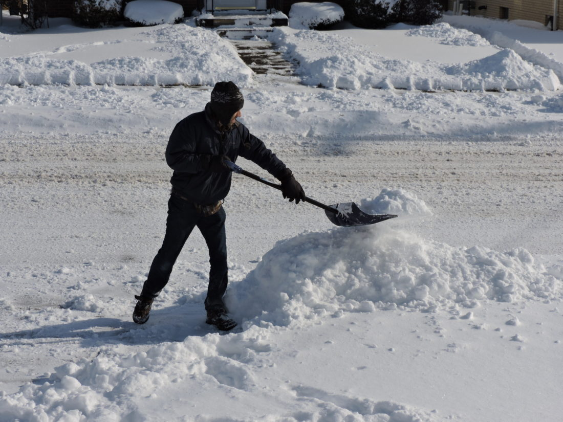 SHOVELINGOUT — Josh Hawrot of Steubenville was busy Saturday morning shoveling approximately six inches of snow from his driveway after a winter stormed moved through the area Friday night. - Dave Gossett