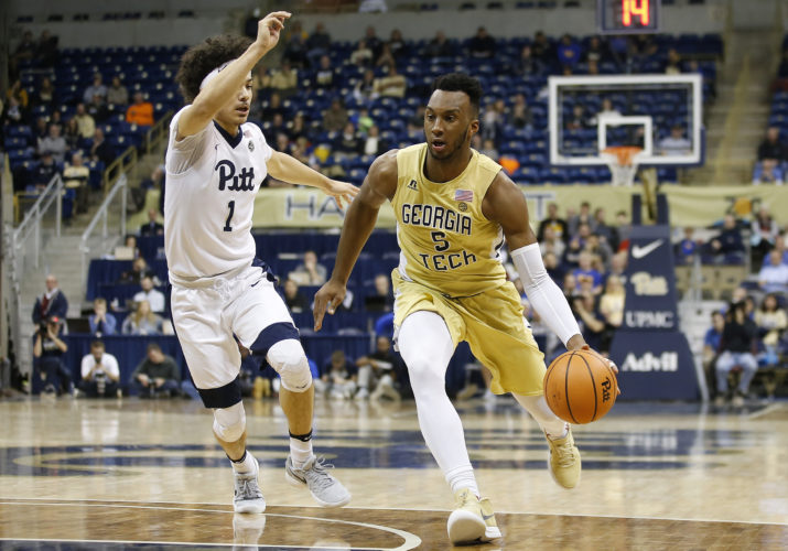 Georgia Tech guard Josh Okogie (5) drives to the basket past Pittsburgh guard Parker Stewart (1) during the first half of an NCAA college basketball game, Saturday, Jan. 13, 2018, in Pittsburgh. (AP Photo/Jared Wickerham)