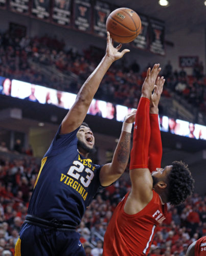 West Virginia's Esa Ahmad (23) shoots the ball over Texas Tech's Brandone Francis (1) during the second half of an NCAA college basketball game, Saturday, Jan. 13, 2018, in Lubbock, Texas. (AP Photo/Brad Tollefson)