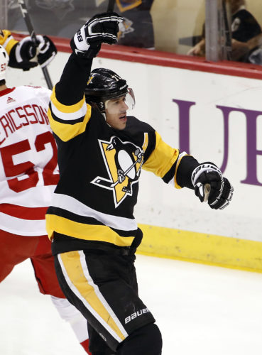 Pittsburgh Penguins' Evgeni Malkin (71) celebrates his goal in the first period of an NHL hockey game against the Detroit Red Wings in Pittsburgh, Saturday, Jan. 13, 2018. (AP Photo/Gene J. Puskar)