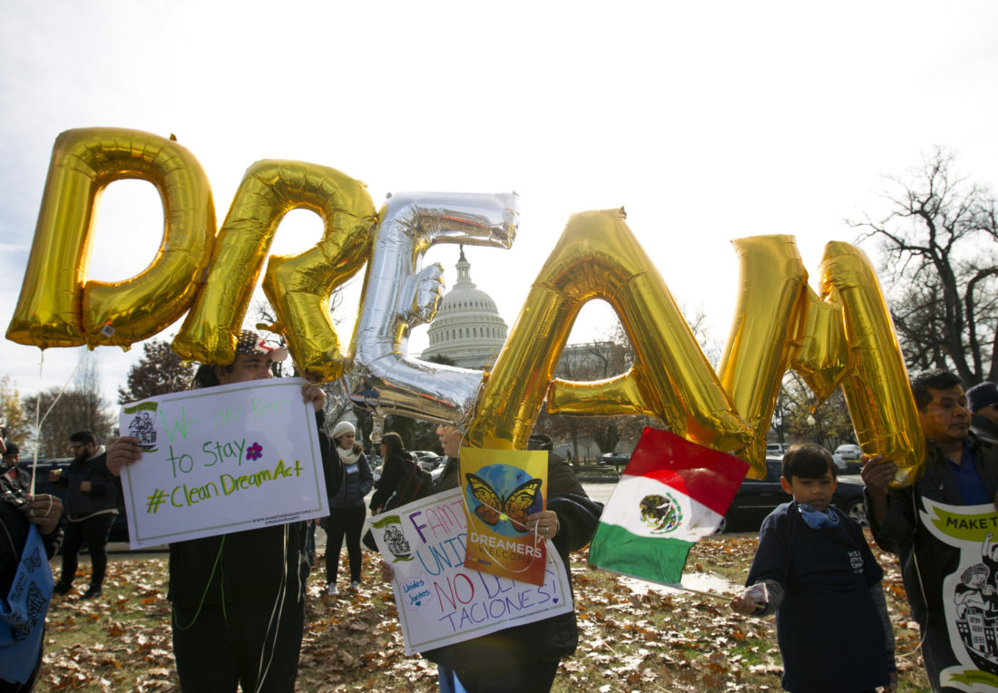 "DYING DREAM — Demonstrators hold up balloons during an immigration rally Dec. 6 in support of the Deferred Action for Childhood Arrivals, and Temporary Protected Status, programs, near the U.S. Capitol in Washington. Casting a cloud over already tenuous negotiations, President Donald Trump said Sunday, that DACA, a program that protects immigrants who were brought to the U.S. as children and live here illegally, is ""probably dead"" and blamed Democrats, days before some government functions would start shutting down unless a deal is reached. -- Associated Press"