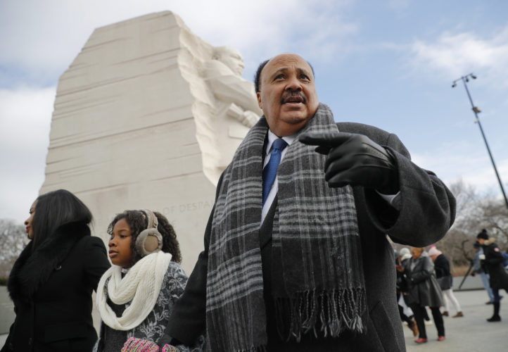 SPECIAL DAY — Martin Luther King III, right, with his wife Arndrea Waters, left, and their daughter Yolanda, 9, center, during their visit to the Martin Luther King Jr. Memorial on the National Mall in Washington, Monday. The son of the late U.S. civil rights activist Martin Luther King Jr., and his family had earlier participated in an event commemorating the life and legacy of his father. -- Associated Press