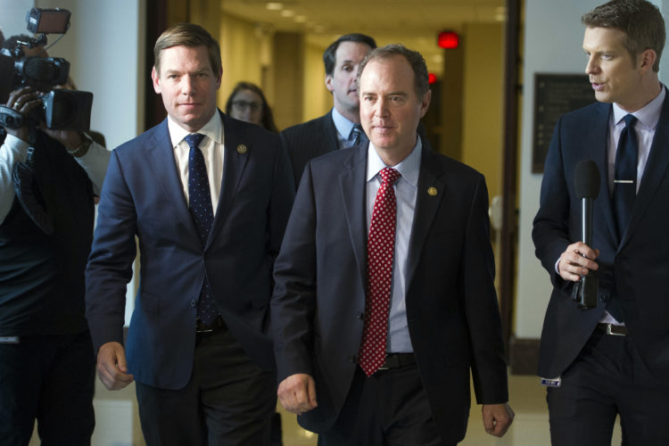 RUSSIAPROBESHOWDOWN — House Intelligence Committee Ranking Member Adam Schiff, D-Calif., center, walks from a committee meeting on Russia where former White House strategist Steve Bannon is testifying, on Capitol Hill in Washington, Tuesday. -- Associated Press