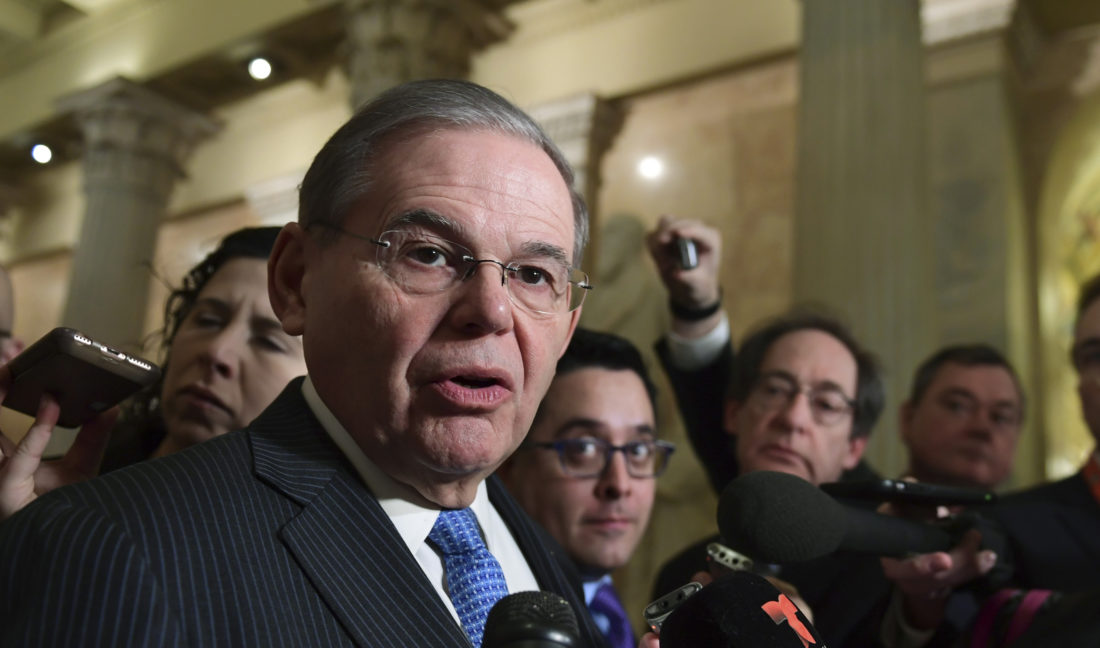 SPEAKING WITH REPORTERS — Sen. Bob Menendez, D-N.J., speaks with reporters on Capitol Hill in Washington, Wednesday, following a meeting with the Congressional Hispanic Caucus and White House Chief of Staff John Kelly.  -- Associated Press