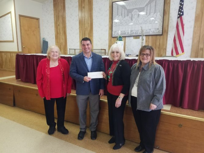 DONATIONS MADE — Among donations made recently by the Weirton Woman's Club were to the United Way of Weirton, where on hand were, from left, Teresa Conley, public issues chair; Luke Myers, United Way campaign vice chair; Diana Durst, club president; and Linda Stear, United Way executive director.  -- Contributed