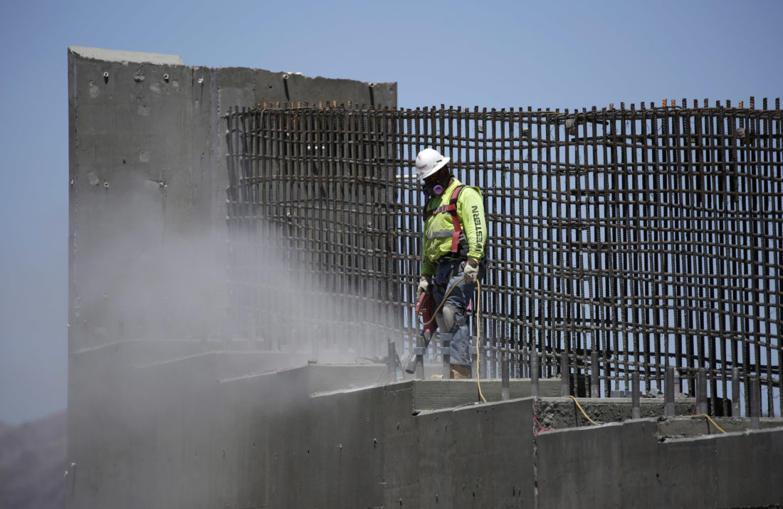 REBUILDING — A man works on the Southern Nevada portion of U.S. Interstate 11 near Boulder City, Nev. President Donald Trump on Monday, unveiled his long-awaited infrastructure plan, a $1.5 billion proposal that fulfills a number of campaign goals, but relies heavily on state and local governments to produce much of the funding. -- Associated Press