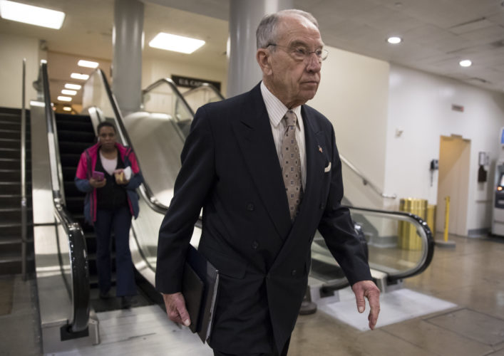 FOCUSONIMMIGRATION — Senate Judiciary Committee Chairman Chuck Grassley, R-Iowa, walks through a basement passageway at the Capitol amid debates in the Senate on immigration, in Washington, Wednesday. President Donald Trump is thanking Grassley for introducing legislation similar to the immigration framework pushed by the White House. -- Associated Press
