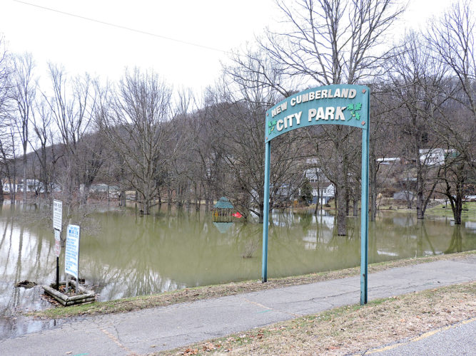 HIGH WATER — New Cumberland Park was among many areas flooded by the Ohio River on Saturday. High water also resulted in state Route 2 through the city and other many roads in Jefferson County being closed. -- Craig Howell