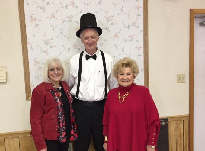 HELLO, MR. LINCOLN — Area resident Jim Crouse impersonated Abraham Lincoln as part of his program presentation at the February meeting of the Weirton Woman's Club. Welcoming him were President Diana Durst, left, and Sandra Robbins, program chairman.  -- Contributed