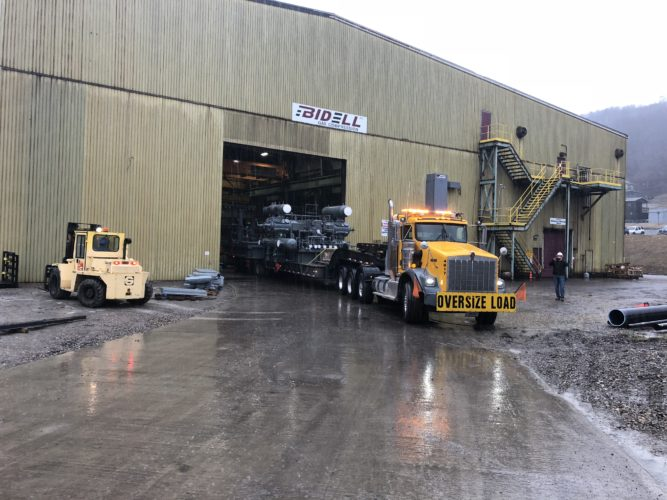 SHIPMENT LEAVING — A portion of the first compressor unit shipment from Bidell Gas Compression is trucked out of the company's Weirton facility Monday morning. Company officials explained multiple truckloads are required for each unit to be delivered. -- Contributed