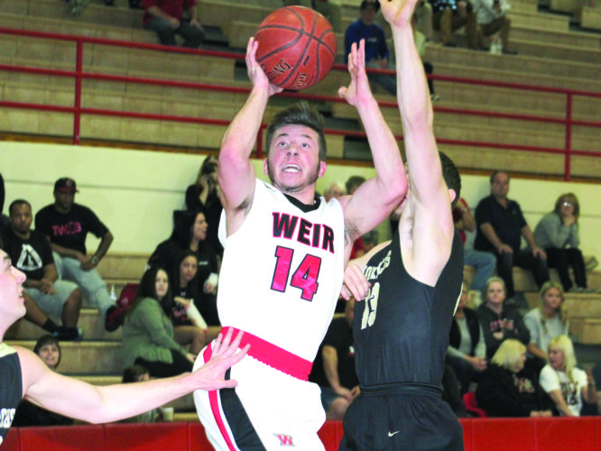 UP AND OVER — Weir High's Cam Pierce attempts a close shot past Wheeling Park's Devin Norris (13) on Tuesday. (Photo by Joe Catullo)