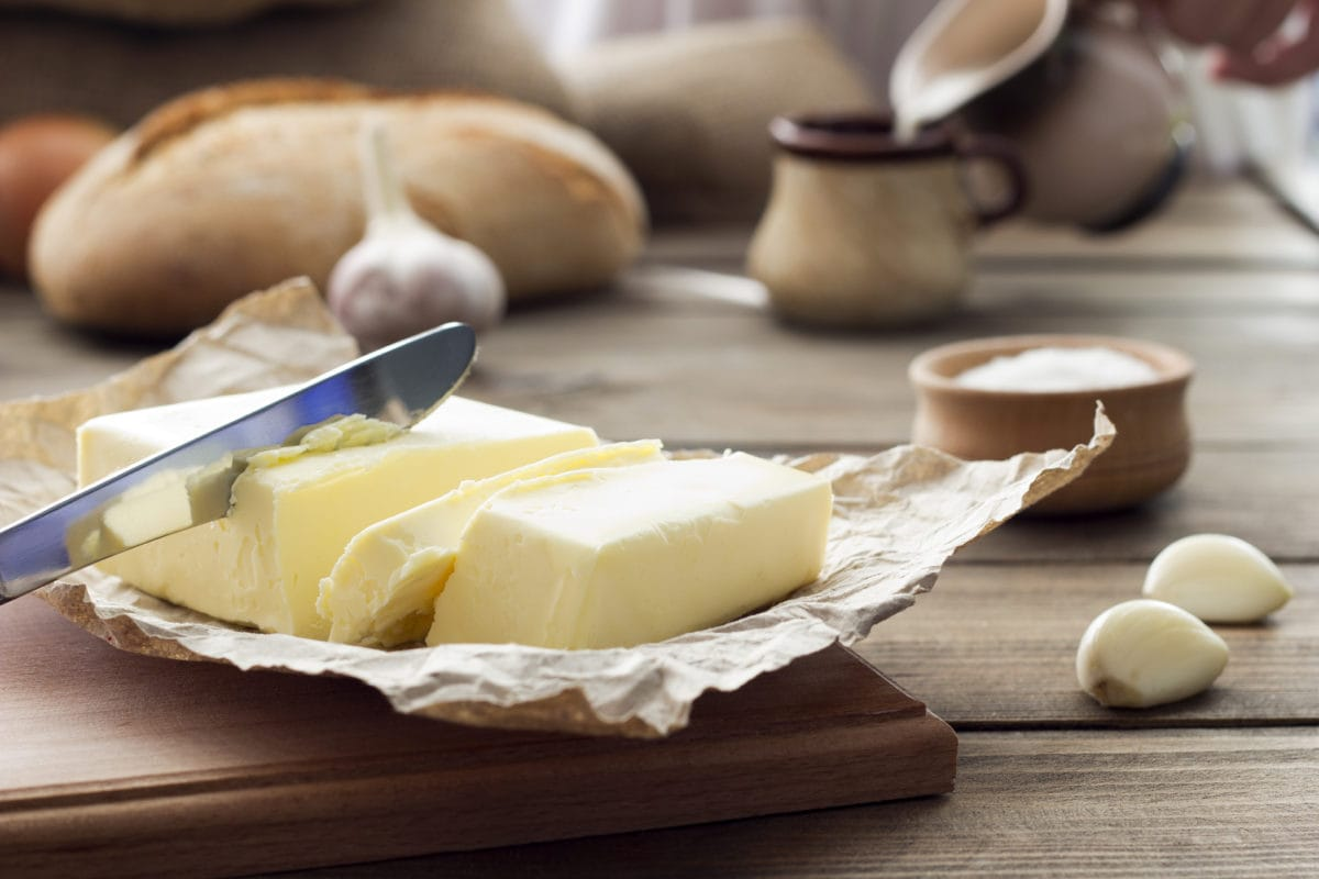 butter and garlic on wooden background