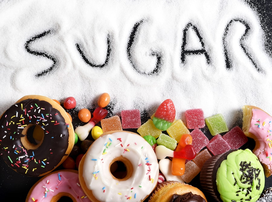Mix Of Sweet Cakes, Donuts And Candy With Sugar Spread And Written