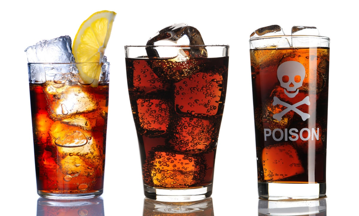 Cola or pepsi filled glasses with the word poison on one of the glasses