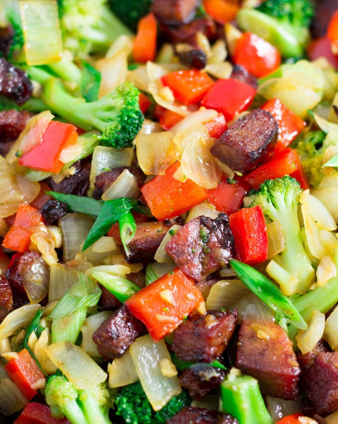 This Hoisin Pork Stir-Fry recipe is the perfect weeknight meal. Simple, no-fuss and quick, this delicious recipe is made with only 8 ingredients and one pan. This recipe was created with a roast pork tenderloin leftover, some green onions, and common vegetables. It is very adaptable as you can swap the meat or veggies with whatever is left in the fridge. Do you have leftover beef or chicken? This recipe has you covered. So don't stress, you probably won't have to hop to the grocery store to make this one! Paleo, Gluten-Free, and Dairy-Free. | www.onecleverchef.com