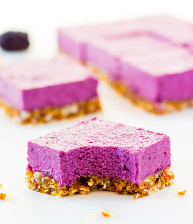These Raw Vegan BlackBerry Cheesecake bars are super creamy and perfectly sweet. This easy no-bake dessert is also extremely healthy! You would never believe it's dessert by simply looking at the nutritional values. This recipe is also Paleo, Gluten-free, Egg-free, Flourless and Dairy-Free! | www.onecleverchef.com