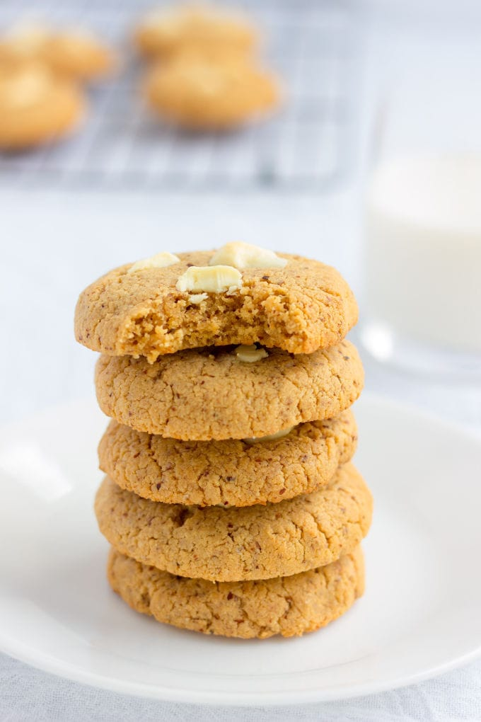 These almond flour & peanut butter protein cookies are my new addiction. Made with only 6 simple ingredients and one bowl, these quick and easy cookies can be whipped up and baked under 20 minutes. Naturally sweetened with coconut sugar, these contain 11 grams of protein per cookie and are entirely gluten-free, paleo, dairy-free, refined sugar-free, flourless, grain-free and can easily be made egg-free and vegan by simply replacing the eggs with flax eggs. Soooo tasty! | www.onecleverchef.com