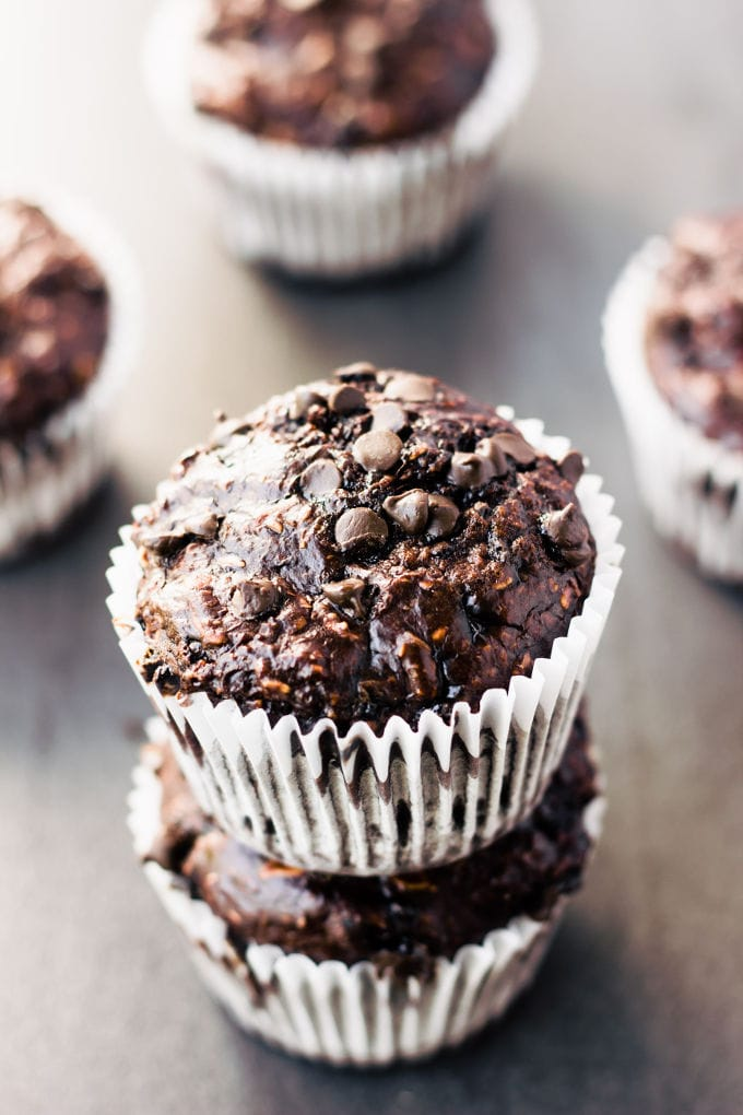 These deliciouschocolate protein muffins are the perfect way to reward yourself after a hard workout. Super moist and cakey, these healthy chocolate protein snacks are naturally sweetened with banana and maple syrup. Gluten-free, vegan, dairy-free, egg-free, flourless, kid-friendly and refined sugar-free. | www.onecleverchef.com
