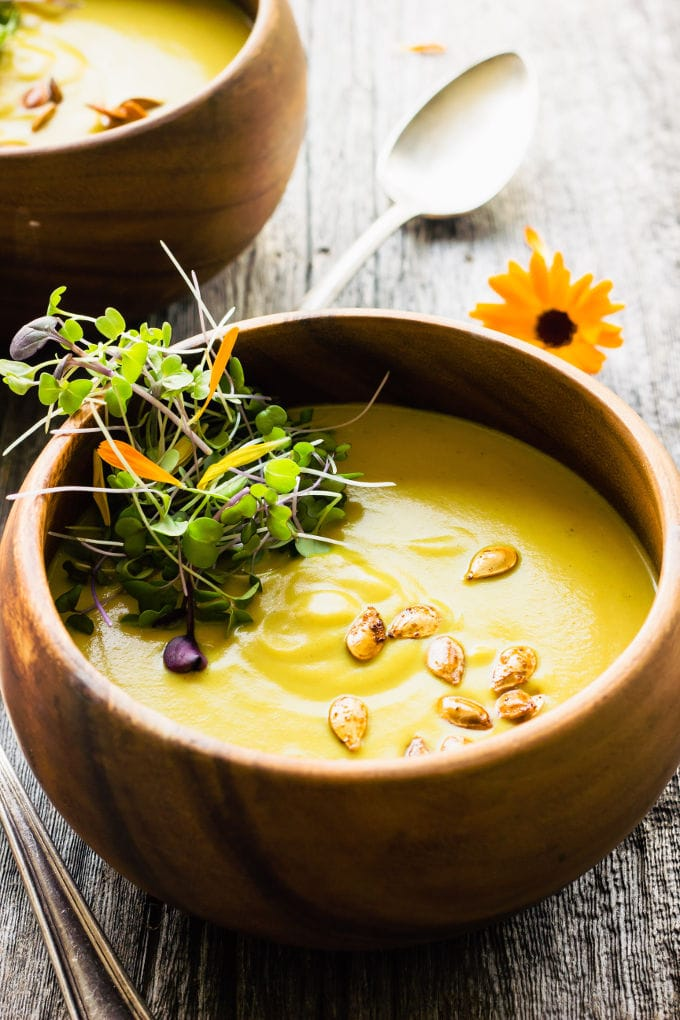 This easy and healthy curried acorn squash soup is the perfect fall comfort food. Sweet and spicy, creamy and savory, this simple potage is also vegan, gluten-free, dairy-free, paleo, vegetarian, flourless, nut-free and sugar-free.   www.onecleverchef.com