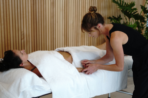 Jenna providing acupuncture treatment to a patient