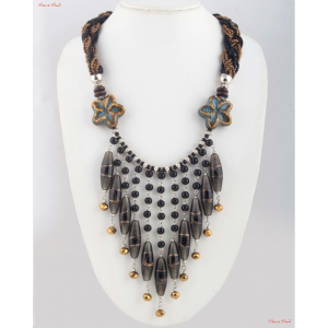 Fashion Necklaces - Dangle neck piece attached to a zigzag patterned cloth with a little bit of flor