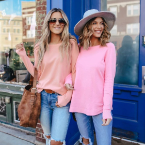 peach and pink sweaters