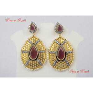 Earrings - Almond shaped ruby in the middle
